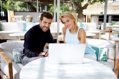 Young executives or couple of professionals working on net-book royalty free stock image