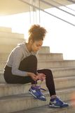 Young exercise woman tying her shoelaces Royalty Free Stock Images