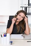 Young exhausted woman with headset Stock Photos