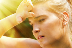 Young, exhausted woman. On a hot day Stock Photography