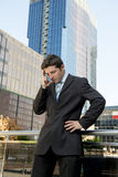 Young exhausted and worried businessman standing outdoors in stress and depression Royalty Free Stock Photo