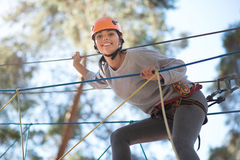 Young exited woman climbing on the ropeway Stock Image