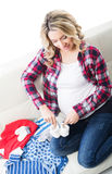 Young expectant mother bought children's wear Royalty Free Stock Image