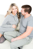 Young expectant mother and father being in love. Happy and smilling young expectant mother and father being in love Stock Image