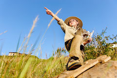 Young explorer. Young child playing pretend adventure explorer with wooden sword and treasure map Royalty Free Stock Photo