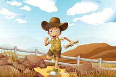 A young explorer running with a map in his hand Royalty Free Stock Photos