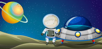 A young explorer beside the spaceship Stock Image