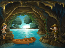 Young explorers inside the cave Royalty Free Stock Images