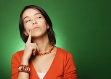 Young expression woman over green background Royalty Free Stock Photos