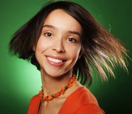 Young expression woman over green background Royalty Free Stock Image
