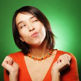 Young expression woman over green background Royalty Free Stock Photo