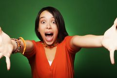 Young expression woman over green background Stock Photo