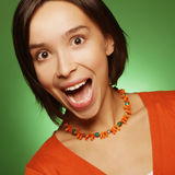 Young expression woman over green background Royalty Free Stock Photography