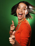 Young expression woman over green background Stock Photos