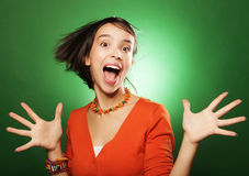 Young expression woman over green background Stock Images