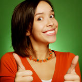Young expression woman over green background Royalty Free Stock Images