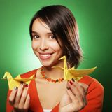 Young expression woman with paper bird Royalty Free Stock Image
