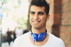 Young man listening something. Outdoors. royalty free stock photo