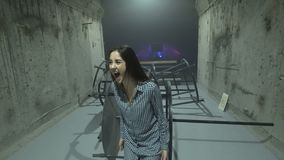 Woman posing in loft club. Young expressive woman screaming and posing among concrete walls of modern grungy club stock video