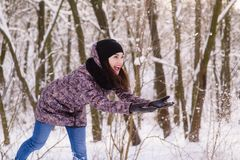 Young expressive woman throw the snow outdoors royalty free stock photo