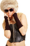 Young exquisite lady in fur hat Royalty Free Stock Images