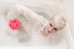 The young extraordinary man in a bath Stock Photos