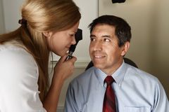 Young eye Doctor during a patient examination Royalty Free Stock Photography
