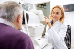 Young eye doctor work using apparatus in eye ambulance Royalty Free Stock Photography