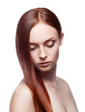 Young famale with long natural red hair. Horizontal studio portrait of young attractive caucasian female with gorgeous luxury long natural straight red hair Stock Photo