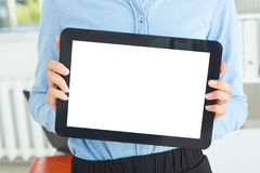 Young famale secretary holding tablet in hands sitting at office. Royalty Free Stock Photo