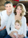 Young famile of three at home Royalty Free Stock Images