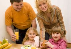 Young family. Have a breakfast at the table Royalty Free Stock Image