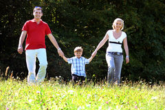 Young family. With one child Royalty Free Stock Photo