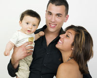 Young family. A studio portrait of a adorable young family posing Stock Photo