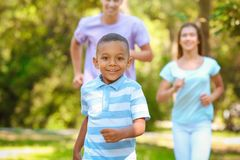 Young family with adopted African American boy. Having fun outdoors Royalty Free Stock Photo