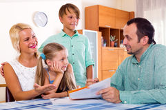 Young family and the agent Stock Image