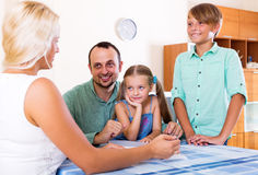 Young family and the agent Royalty Free Stock Photo