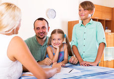 Young family and the agent Stock Photography