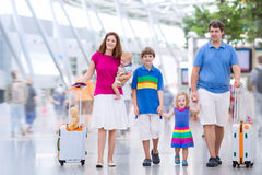 Young family at the airport stock images