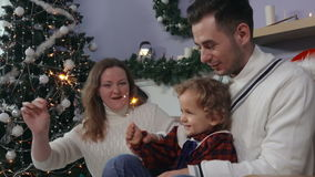 Young family around the Christmas tree stock video