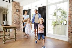 Young family arriving back to their home royalty free stock photos