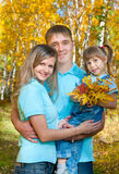Young family, autumn royalty free stock image