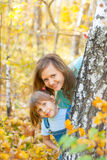 Young family in autumn forest Stock Photo