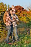 Young family in autumn forest Royalty Free Stock Photos