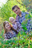 Young family in autumn forest Royalty Free Stock Photo