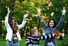 Young family in autumn park Royalty Free Stock Photo