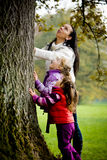 Young family in the autumn park Royalty Free Stock Photo