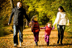 Young family in the autumn park Royalty Free Stock Photos