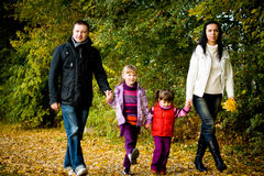 Young family in the autumn park Stock Photos