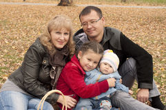Young family in autumn park Royalty Free Stock Image